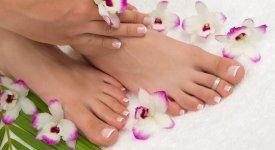 inger and toenails painted at nail salon Photo