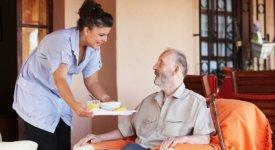Home Healthcare Nurse serving Lunch Photo