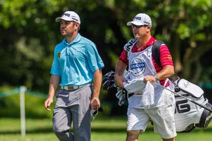 Golf Caddy Instructs Golfer Photo