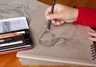 Illustrator working on illustration