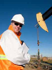 Pumpjack Worker Poses for Photo
