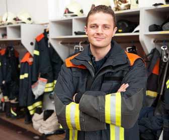Fireman in Fire Gear Room Photo