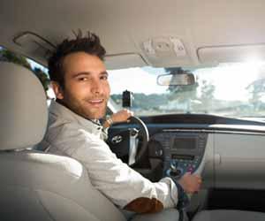 UberX Driver Smiles to Passengers in Backseat Photo