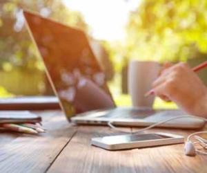 Freelancer working outside on laptop