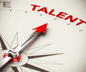 "Compass with red arrow pointing toward ""Talent"""