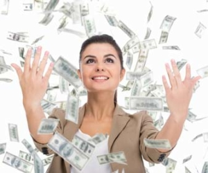 Woman throwing money in air with high paying job