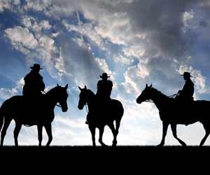 Three Dude Ranch Wranglers on Horses