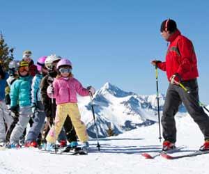 Ski Instructor Teaching Children's Ski School Class