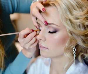 Makeup Artist Works on Client