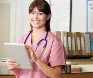 Nurse at Nurse Station with Tablet