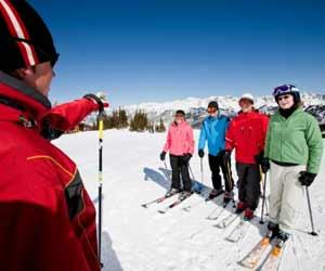 Ski Instructor Teaching Adult Ski School Class