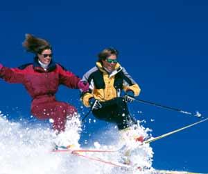 Couple Skiing Powder in Sun Valley Idaho