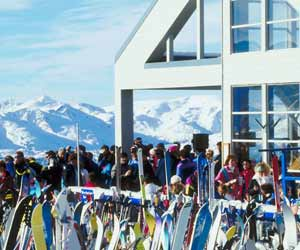 Gentil Skiers Enjoying The Sun During Lunch At An On The Mountain Ski Lodge