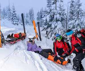 Ski Patrol Attending to Injured Skier
