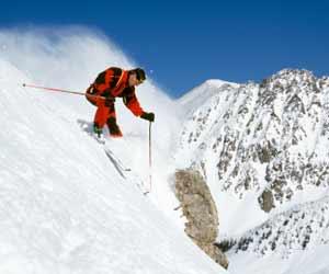 Skier Skiing Steep Ski Slope in Utah