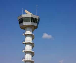 Air traffic control tower against blue sky