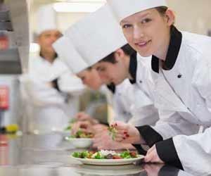 Restaurant Kitchen Staff Preparing Salads for Customers