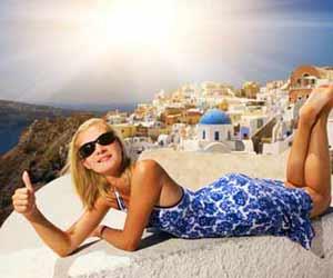 ESL Teacher in Greece Poses for a Photo in Santorini