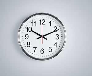 Clock set at 10:11 AM on blank wall