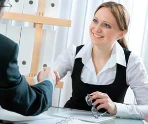 Job interviewer shaking job candidates hand
