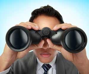 Job recruiter with massive binoculars looking for job seekers