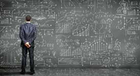 Data Scientist Staring at Blackboard