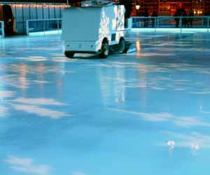 Zamboni Driver Prepares Ice for Hockey Game