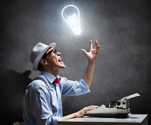Man at typewriter has a brilliant idea