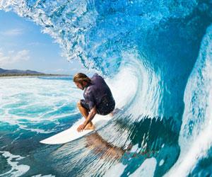 Big wave surfer in the barrel of a wave