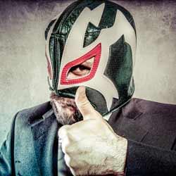 A Professional Wrestler Provides Excellent Showmanship During a Scripted Match